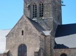 De ongelukkige parachutist John Steele hangt nog steeds aan de  kerktoren van Sainte-Mère-Eglise