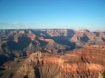 Het rode gesteente van de Grand Canyon is op zijn mooist vlak na zonsopgang en even voor zonsondergang (zoals hier op deze foto aan Maricopa Point).